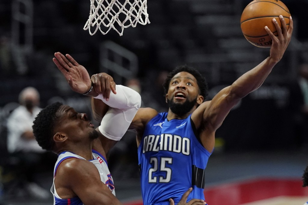 Orlando Magic guard Chasson Randle (25) makes a layup as Detroit Pistons forward Tyler Cook defends during the second half of an NBA basketball game, ...