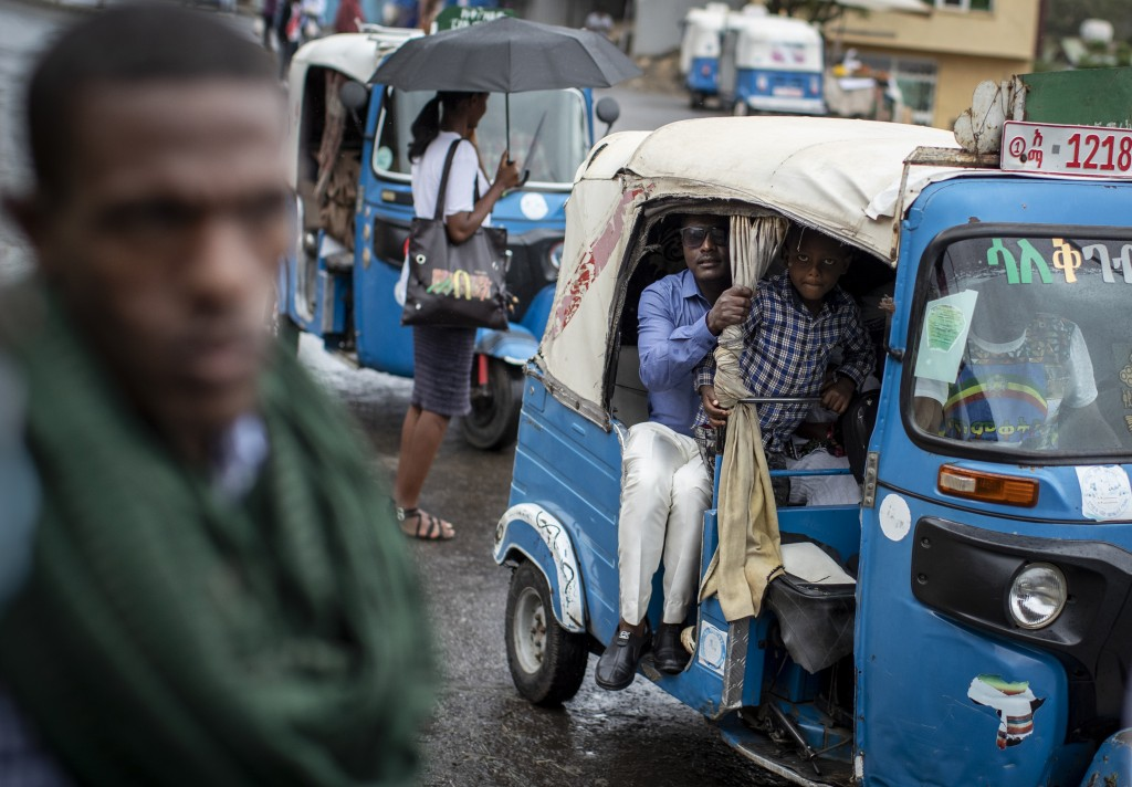 """Passengers look out from an auto-rickshaw, known locally as a """"bajaj"""", in Gondar, in the Amhara region of Ethiopia Sunday, May 2, 2021. Ethiopia faces..."""