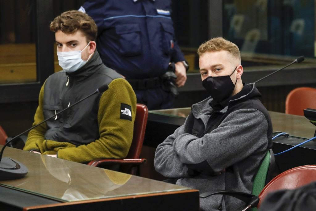 FILE -- In this April 29, 2021 file photo, Gabriel Natale-Hjorth, left, and his co-defendant Finnegan Lee Elder, both from the United States, wear fac...
