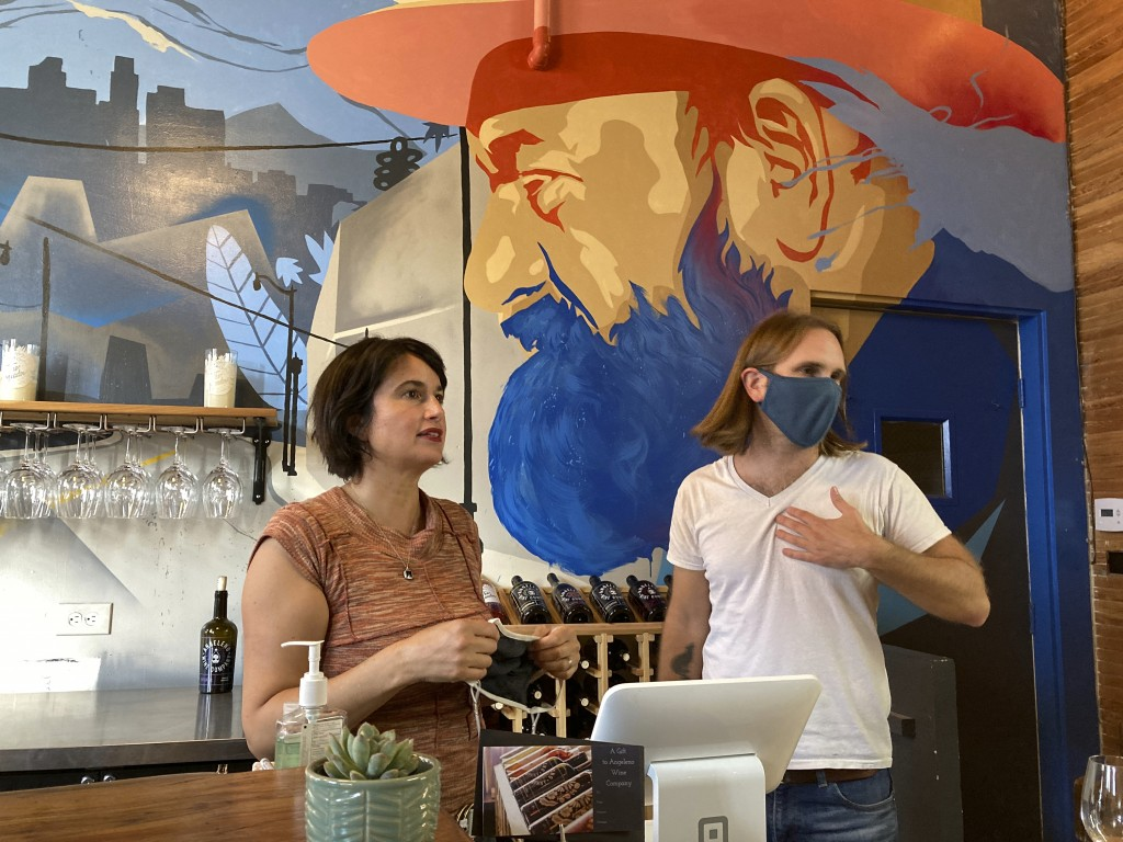 In this Sunday, May 2, 2021, photo, Angeleno Wine Company owners Amy Luftig Viste, left, and Jasper Dickson pose for a picture in downtown Los Angeles...