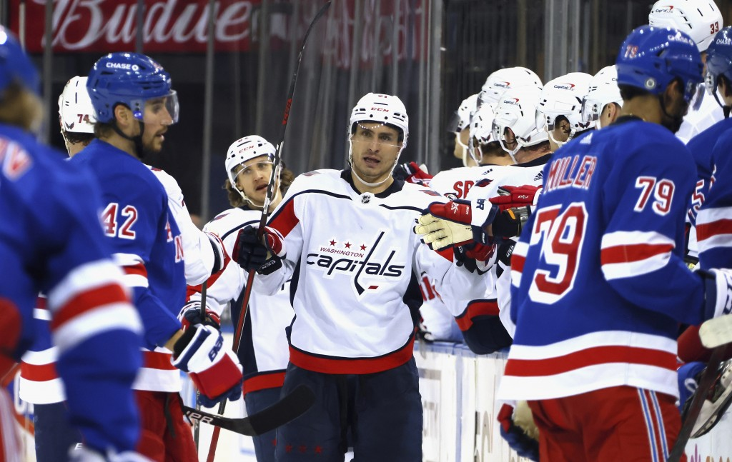 Garnet Hathaway, center, of the Washington Capitals celebrates his second-period goal against the New York Rangers during an NHL hockey game Monday, M...