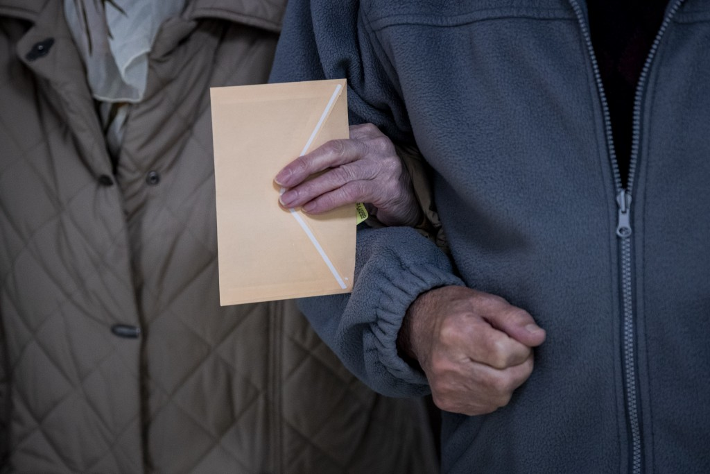 An elderly couple walk into a polling station during the regional election in Madrid, Spain, Tuesday, May 4, 2021. Over 5 million Madrid residents are...
