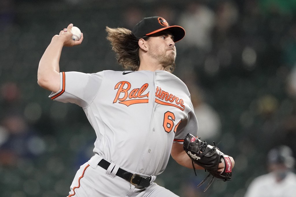 Baltimore Orioles starting pitcher Dean Kremer throws against the Seattle Mariners during the first inning of a baseball game, Monday, May 3, 2021, in...