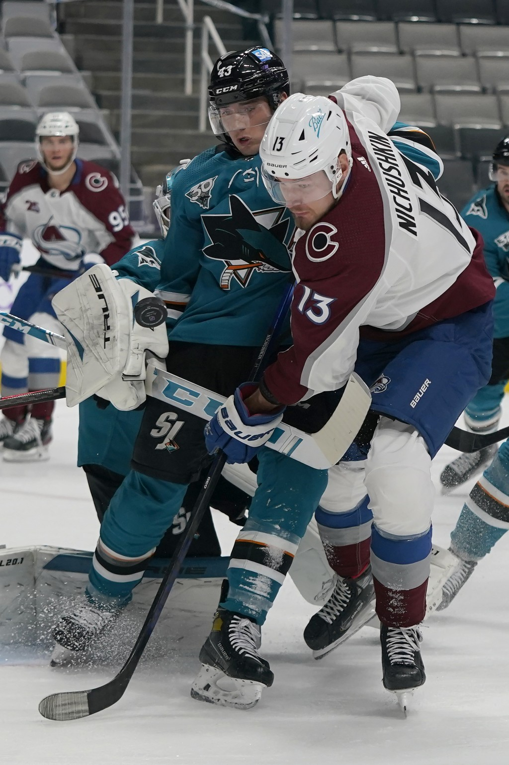 Colorado Avalanche right wing Valeri Nichushkin (13) looks toward the puck in front of San Jose Sharks left wing John Leonard (43) during the second p...