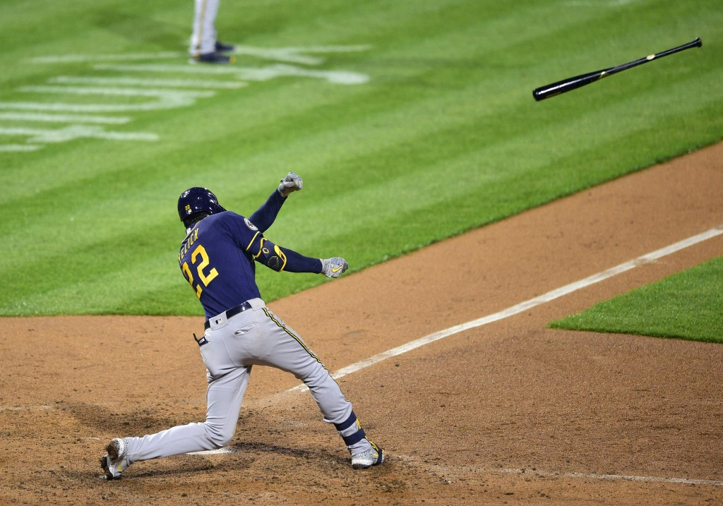 Milwaukee Brewers Christian Yelich loses grip of his bat during the eighth inning of a baseball game against the Philadelphia Phillies, Monday, May 3,...