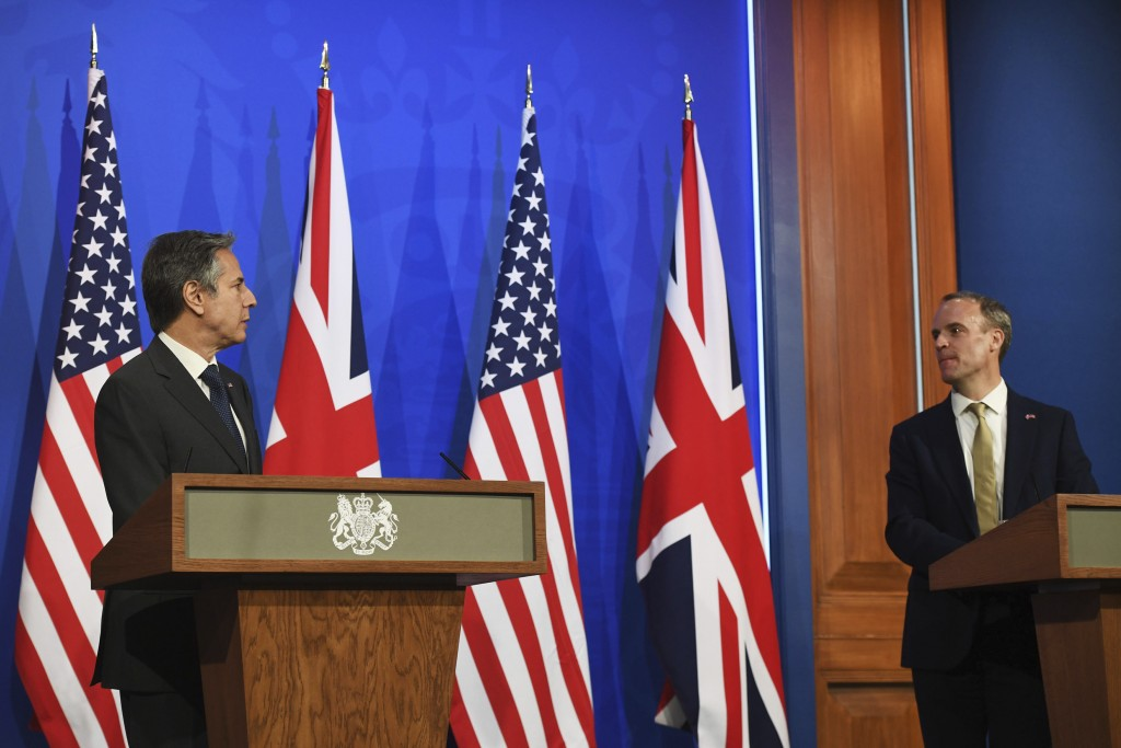 In this May 3, 2021, photo, Britain's Foreign Secretary Dominic Raab, right, and U.S. Secretary of State Antony Blinken speak at a news conference at ...