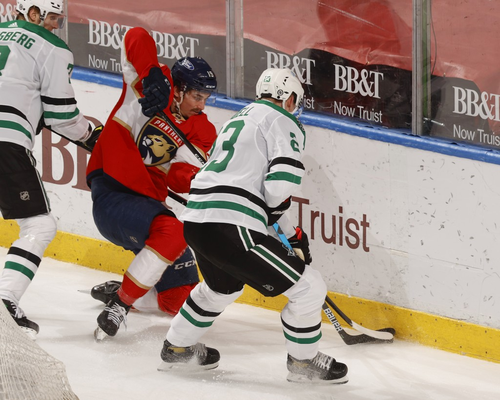 Florida Panthers left wing Mason Marchment (19) and Dallas Stars defenseman Esa Lindell (23) battle for control of the puck during the second period o...