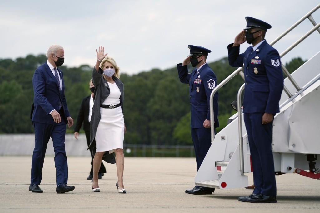 President Joe Biden and first lady Jill Biden wave as they board Air Force One to depart at the Newport News/Williamsburg International Airport, Monda...