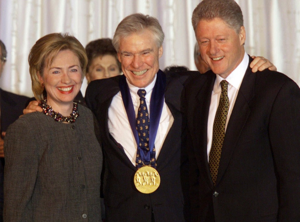 FILE - Dancer-choreographer Jacques d'Amboise poses with President Bill Clinton, right, and first lady Hillary Rodham Clinton at the White House after...