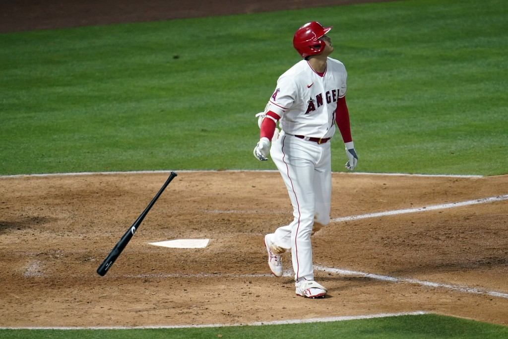 Los Angeles Angels' Shohei Ohtani drops his bat as he hits a two-run home run during the sixth inning of a baseball game against the Tampa Bay Rays Mo...