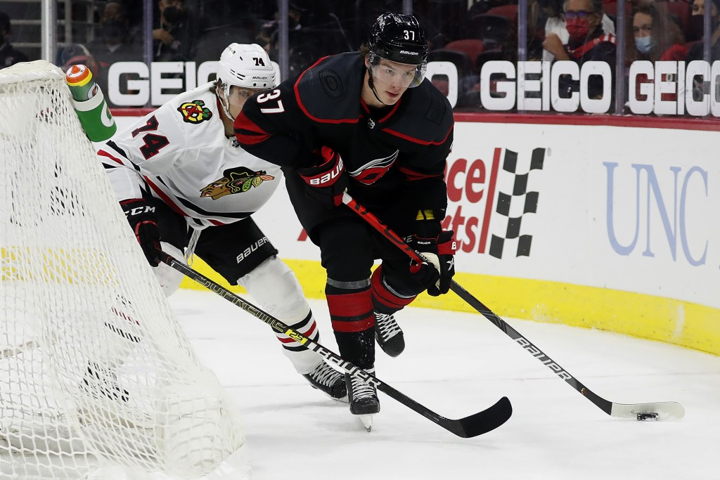 Carolina Hurricanes' Andrei Svechnikov (37) moves the puck against Chicago Blackhawks' Nicolas Beaudin (74) during the second period of an NHL hockey ...