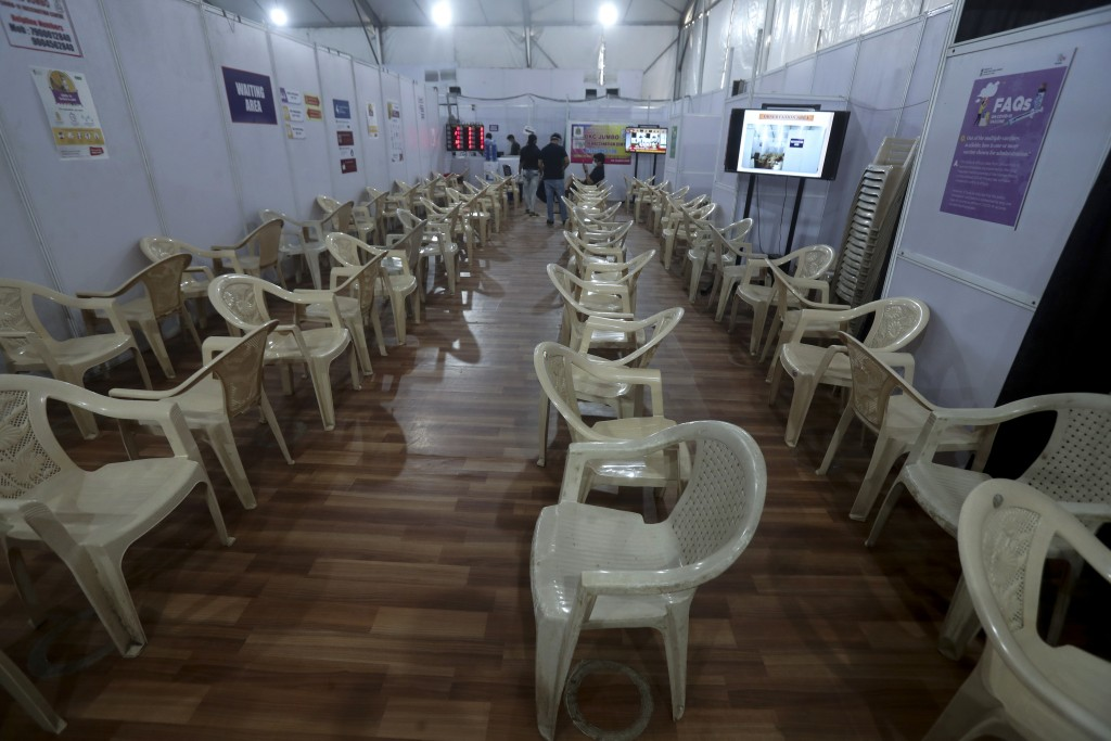 FILE - In this May. 3, 2021, file photo, health workers sit in the waiting area of vaccination center which has been closed because of shortage of the...