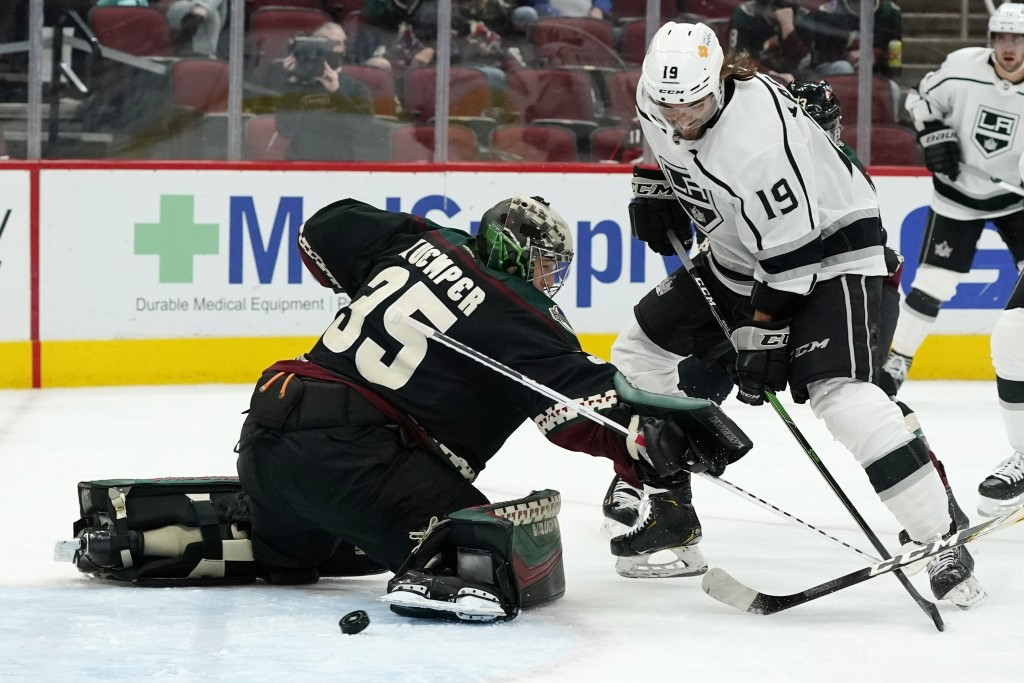 Los Angeles Kings right wing Alex Iafallo (19) beats Arizona Coyotes goaltender Darcy Kuemper (35) for a goal during the second period of an NHL hocke...