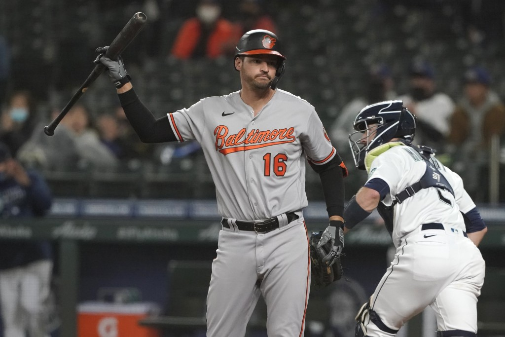 Baltimore Orioles' Trey Mancini (16) reacts after striking out swinging during the third inning of a baseball game against the Seattle Mariners, Monda...
