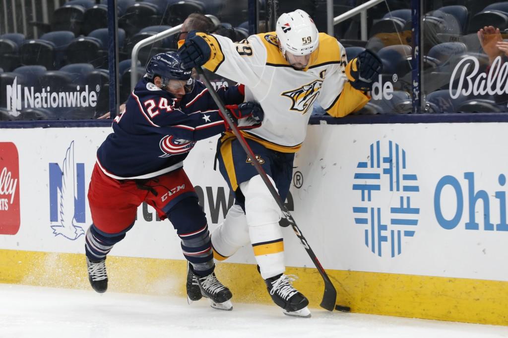olumbus Blue Jackets' Nathan Gerbe, left, checks Nashville Predators' Roman Josi during the second period of an NHL hockey game Monday, May 3, 2021, i...