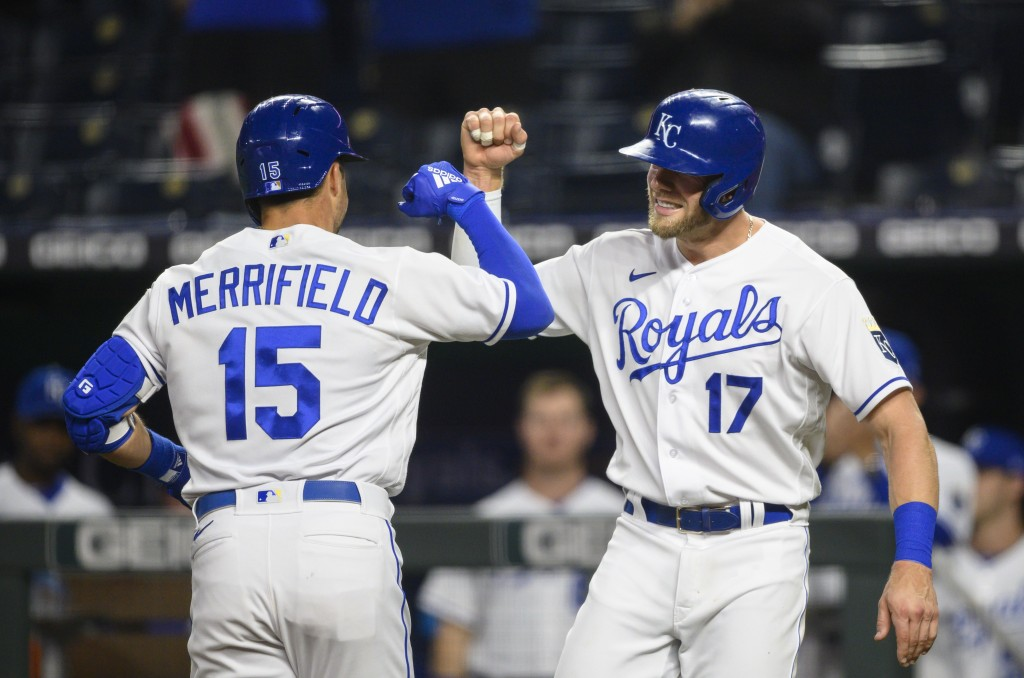 Kansas City Royals Hunter Dozier, right, congratulates Whit Merrifield, left, after Merrifield hit a home run scoring both of them during the fourth i...
