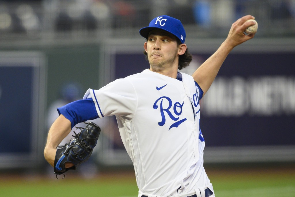 Kansas City Royals starting pitcher Daniel Lynch throws against the Cleveland Indians during the first inning of a baseball game Monday, May 3, 2021, ...
