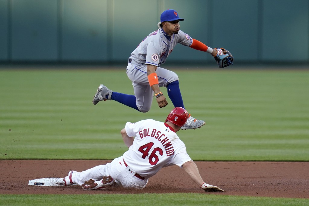 St. Louis Cardinals' Paul Goldschmidt (46) is out at second as New York Mets shortstop Francisco Lindor turns the double play during the first inning ...