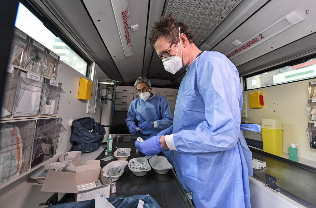 Medical staff prepares Moderna vaccination in a vaccination mobile on a square at the district Chorweiler in Cologne, Germany, Monday, May 3, 2021. Th...