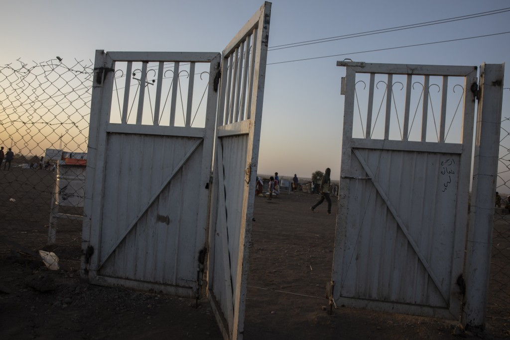 A gate stands open at the Sudanese Red Crescent clinic where surgeon and doctor-turned-refugee, Dr. Tewodros Tefera takes shelter and works in Hamdaye...