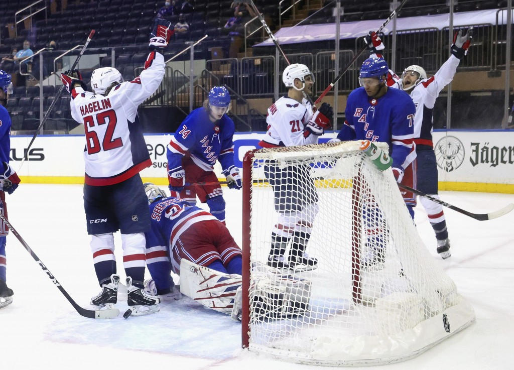 Garnet Hathaway, far right, of the Washington Capitals, celebrates his goal second period against the New York Rangers during an NHL hockey game Monda...