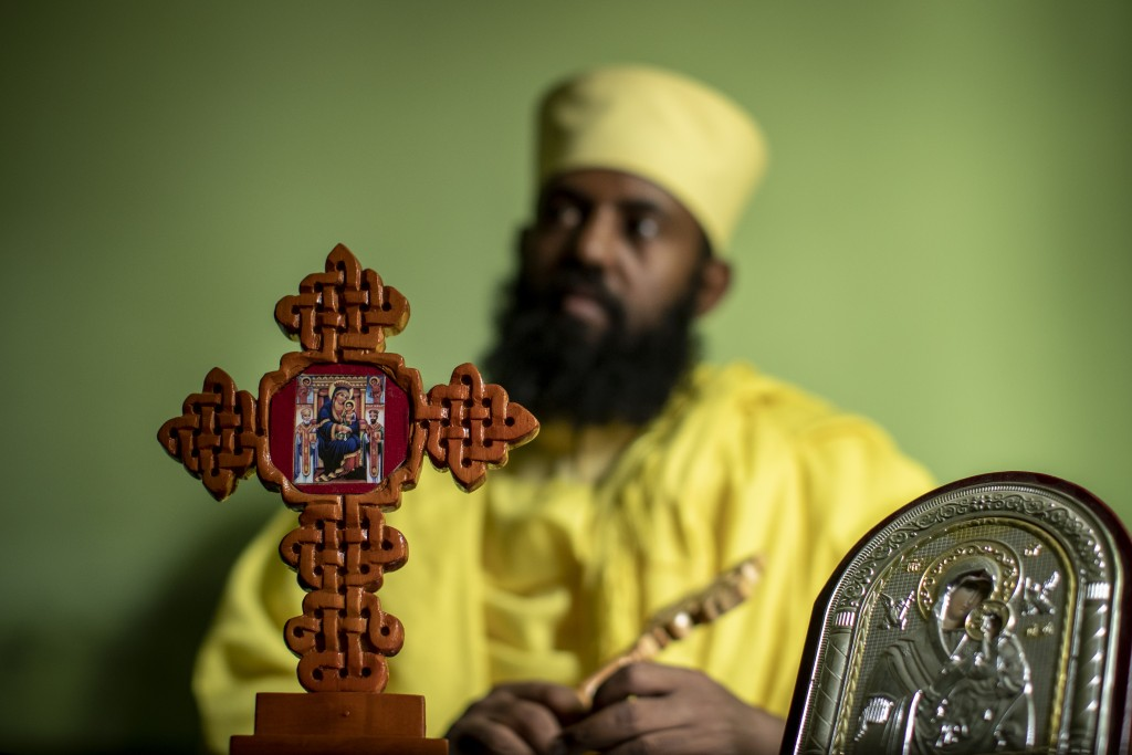 """Ethiopian Orthodox Church priest Aba Yosief Desta, who hopes young people will shun ethnic-driven politics which he calls """"the source of all problems""""..."""