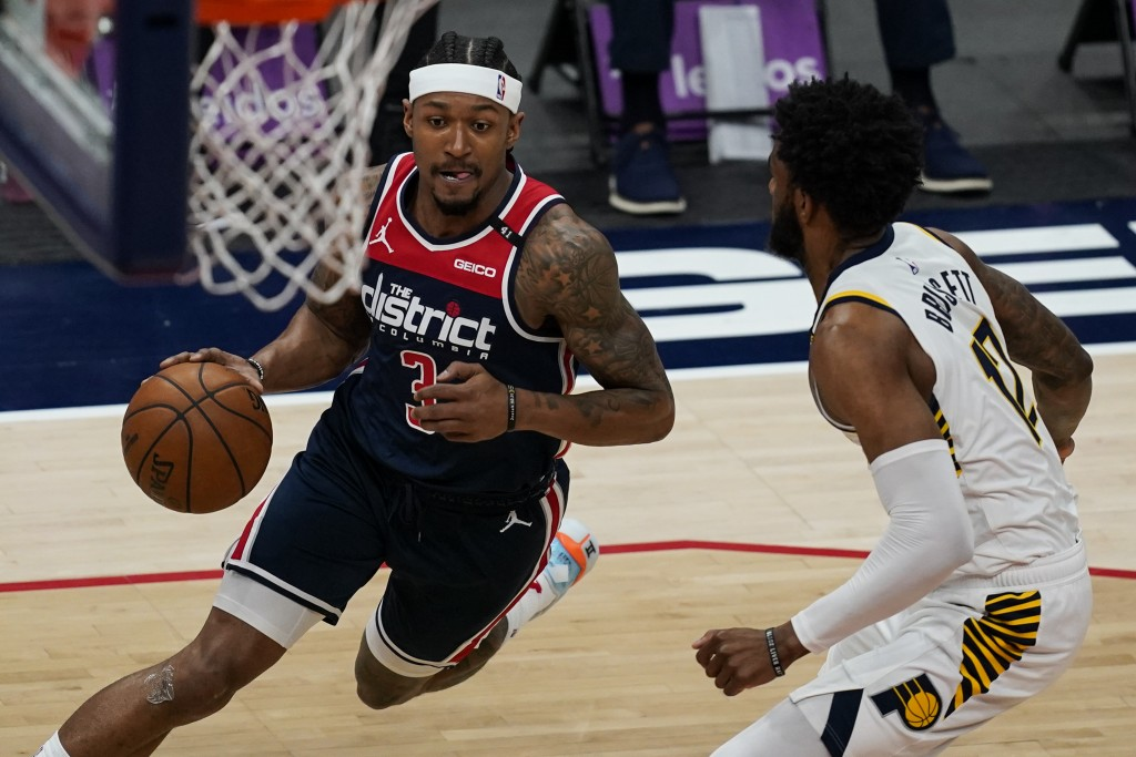 Washington Wizards guard Bradley Beal (3) drives against Indiana Pacers forward Oshae Brissett (12) during the first half of a basketball game, Monday...