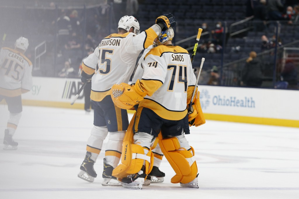 Nashville Predators' Brad Richardson, left, congratulates Juuse Saros after their win over the Columbus Blue Jackets' in an NHL hockey game Monday, Ma...