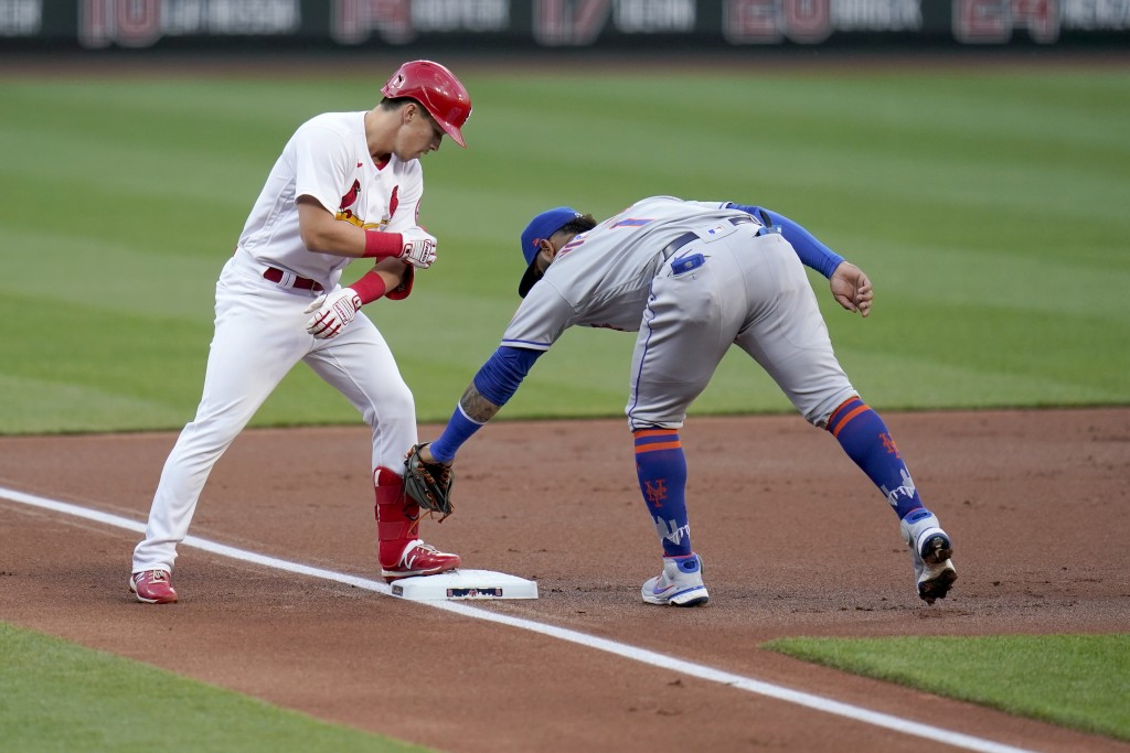 St. Louis Cardinals' Tommy Edman, left, arrives at third for a triple ahead of the tag from New York Mets third baseman Jonathan Villar during the fir...