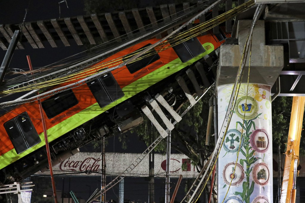 Mexico City's subway cars lay at an angle after a section of Line 12 of the subway collapsed in Mexico City, Tuesday, May 4, 2021. The section passing...