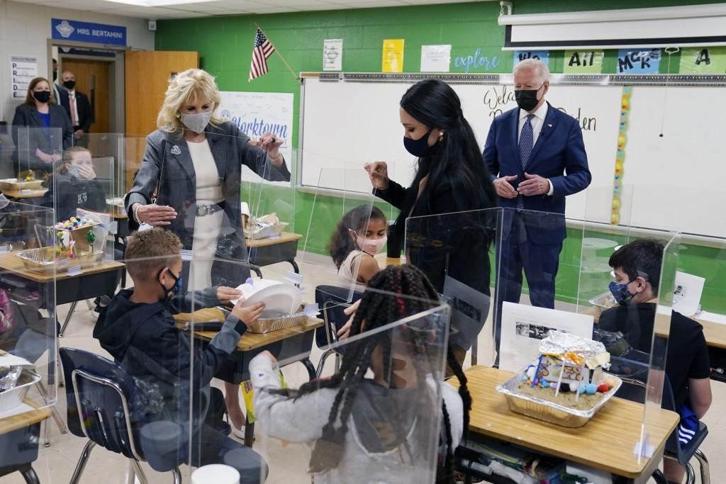 President Joe Biden, first lady Jill Biden and fifth-grade teacher Cindy Bertamini, watch a student demonstrate his project, during a visit to Yorktow...