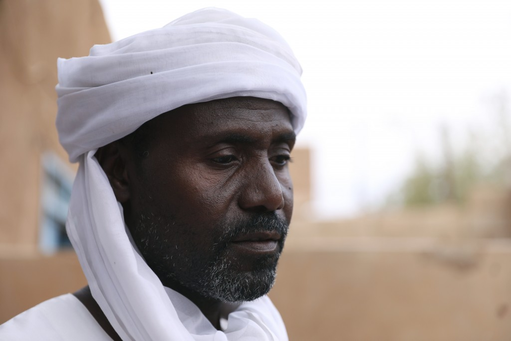 Abdullah Jaber, whose son Mubarak died in a migrant ship sinking last month, sits at his home in Khartoum, Sudan,  Friday, April 30 2021. When more th...