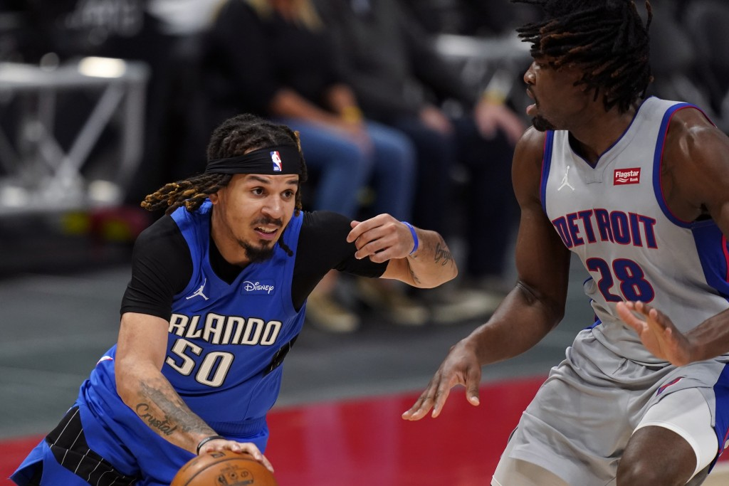 Orlando Magic guard Cole Anthony (50) drives as Detroit Pistons center Isaiah Stewart (28) defends during the second half of an NBA basketball game, M...
