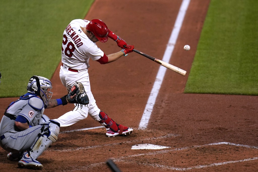 St. Louis Cardinals' Nolan Arenado hits a three-run home run during the third inning of a baseball game against the New York Mets Monday, May 3, 2021,...