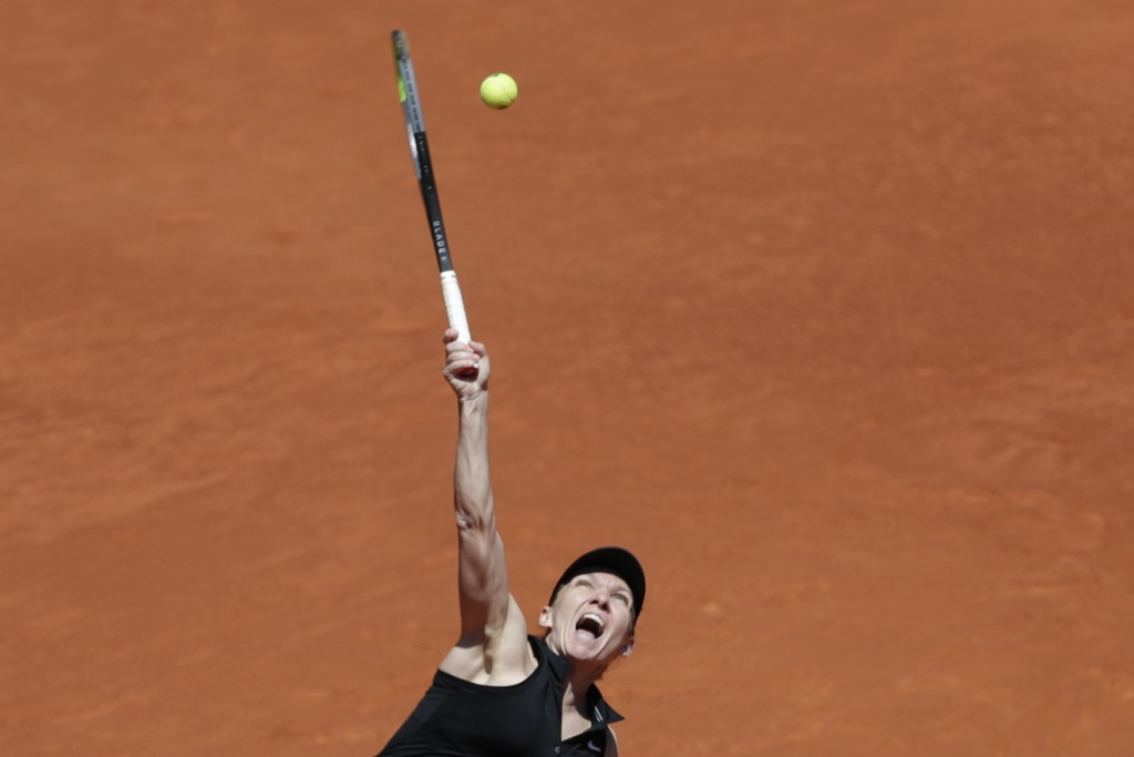 Simona Halep of Romania serves to Elise Mertens of Belgium during their match at the Madrid Open tennis tournament in Madrid, Spain, Tuesday, May 4, 2...