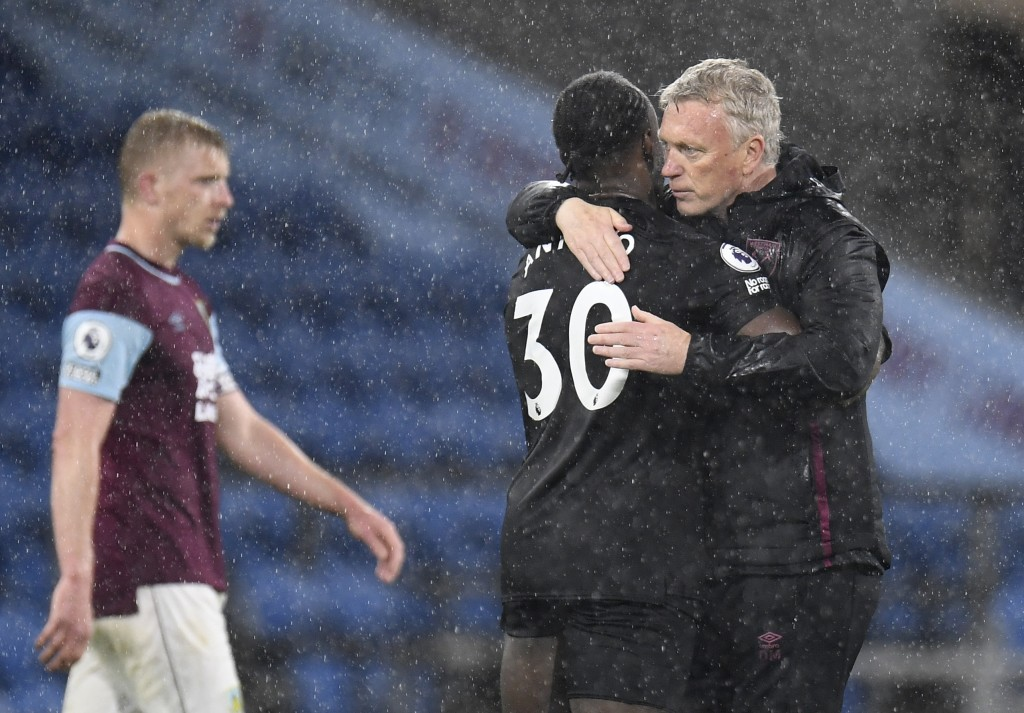 West Ham's manager David Moyes, right, hugs West Ham's Michail Antonio on the pitch after the end of the English Premier League soccer match between B...