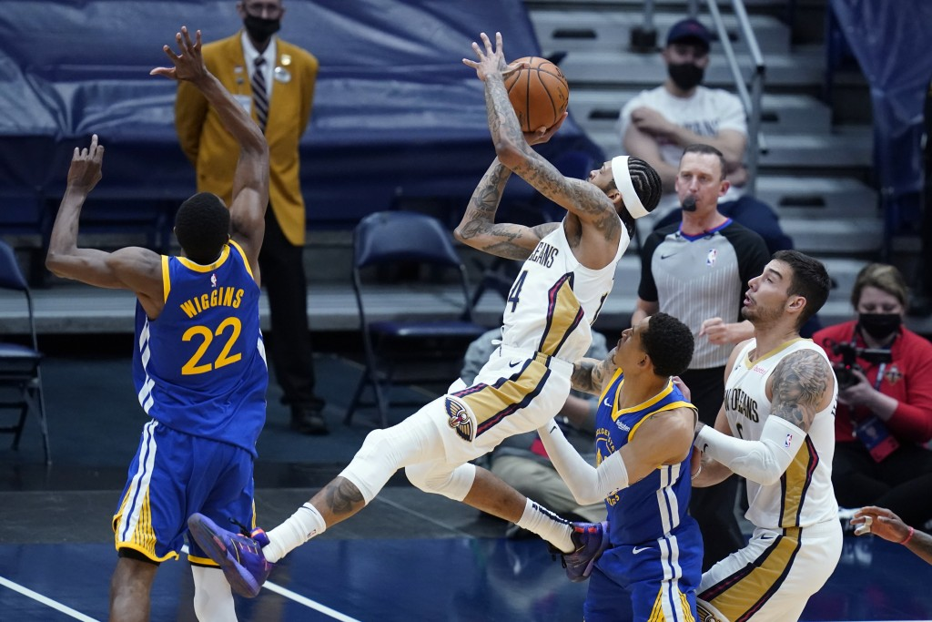 New Orleans Pelicans forward Brandon Ingram shoots between Golden State Warriors forward Andrew Wiggins (22) and guard Jordan Poole in the first half ...