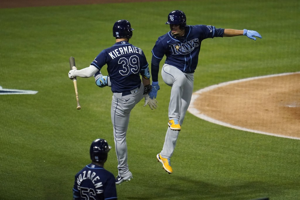 Tampa Bay Rays' Willy Adames, right, celebrates his solo home run with Kevin Kiermaier (39) during the fourth inning of a baseball game against the Lo...