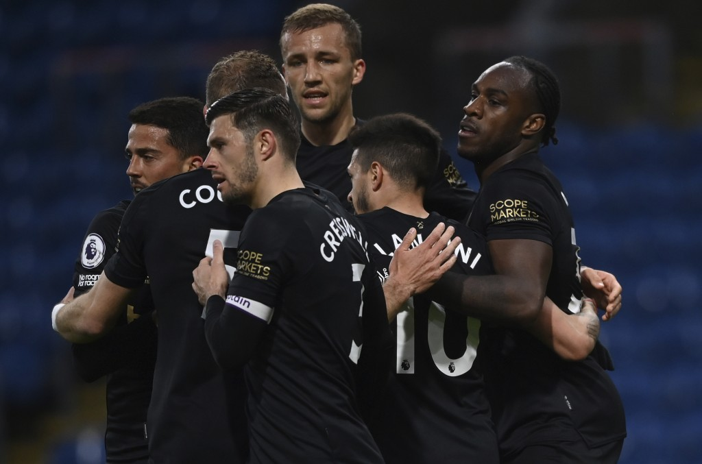 West Ham's Michail Antonio, right celebrates with teammates after scoring his sides 1st goal during the English Premier League soccer match between Bu...