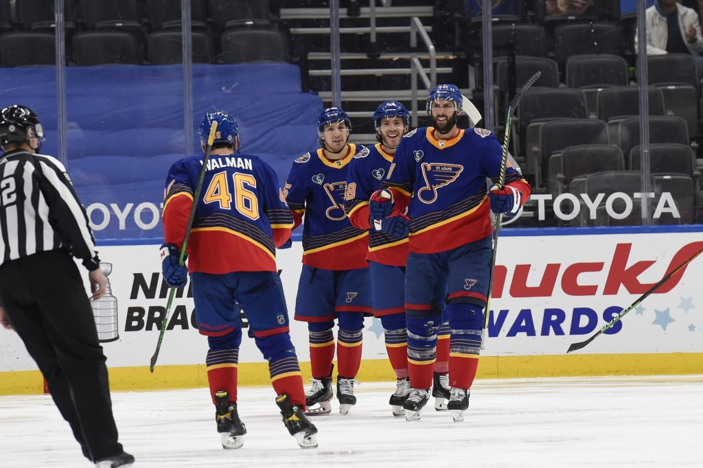 St. Louis Blues' Robert Bortuzzo (41) is congratulated by teammates after scoring a goal against the Anaheim Ducks during the third period of an NHL h...