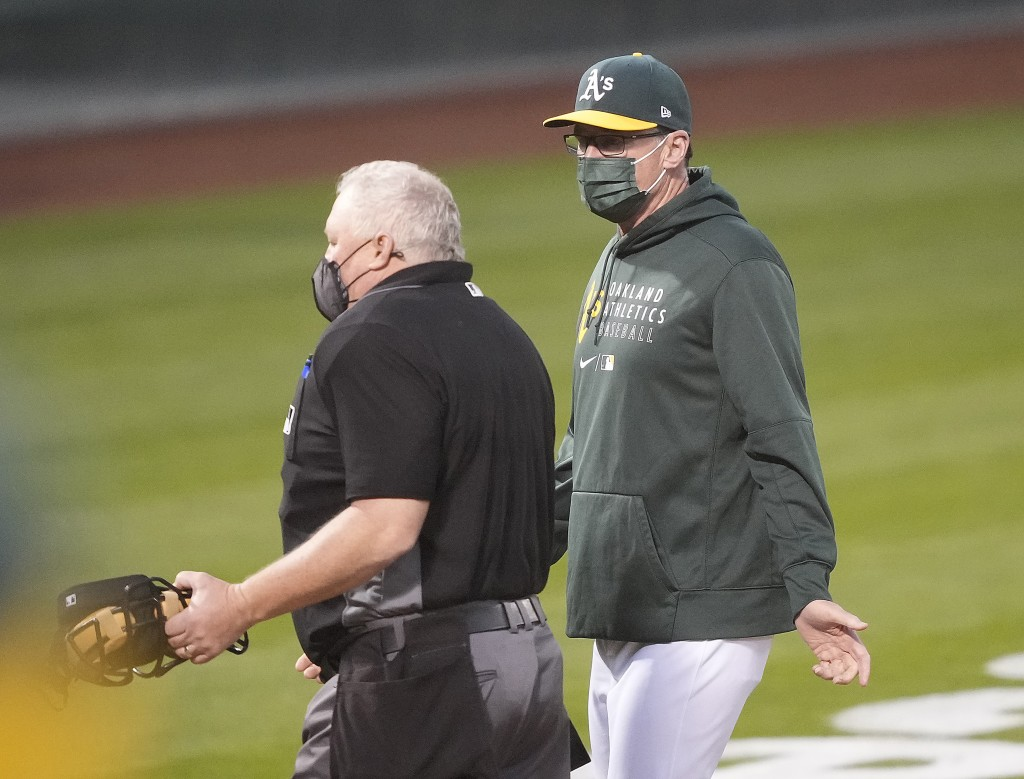 Oakland Athletics manager Bob Melvin, right, argues a call by umpire Bill Miller during the fourth inning against the Toronto Blue Jays in a baseball ...