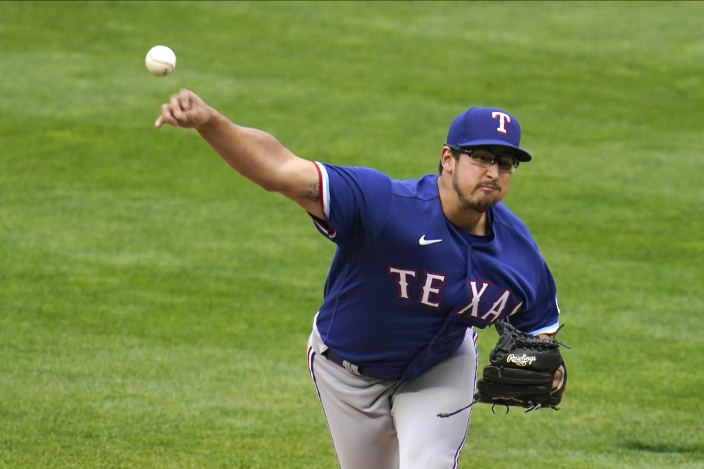 Texas Rangers pitcher Dane Dunning throws against the Minnesota Twins in the first inning of a baseball game, Monday, May 3, 2021, in Minneapolis. (AP...