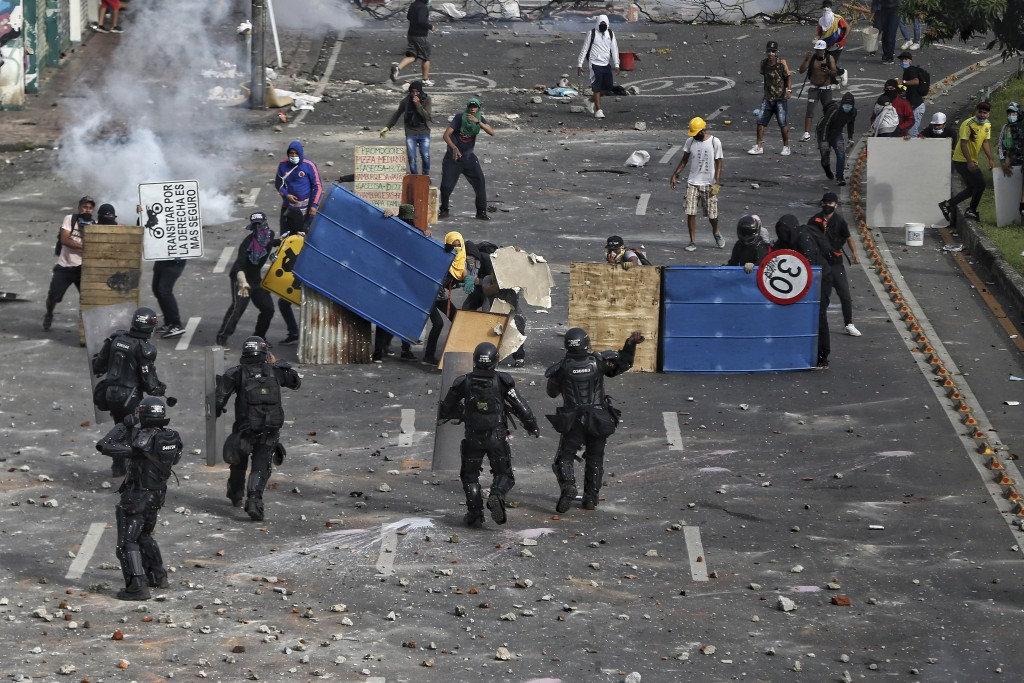 Protesters clash with police during a national strike against tax reform in Cali, Colombia, Monday, May 3, 2021. Colombia's President Ivan Duque withd...