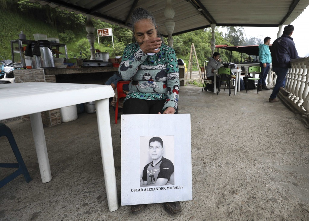 Doris Tejada, mother of Oscar Alexander Morales who disappeared on New Year's eve 2007, holds a photo of her son, at a shop in Soacha, Colombia, Thurs...