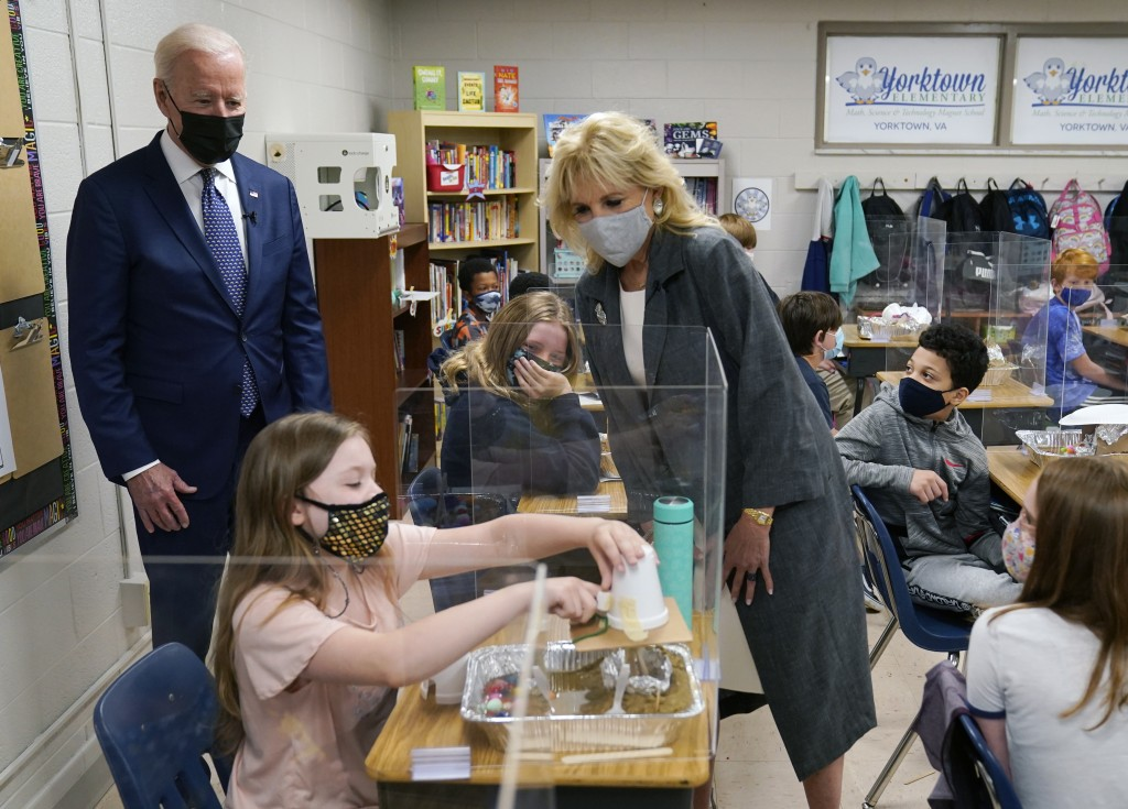 President Joe Biden and first lady Jill Biden, watch a student demonstrate her project, during a visit to Yorktown Elementary School, Monday, May 3, 2...