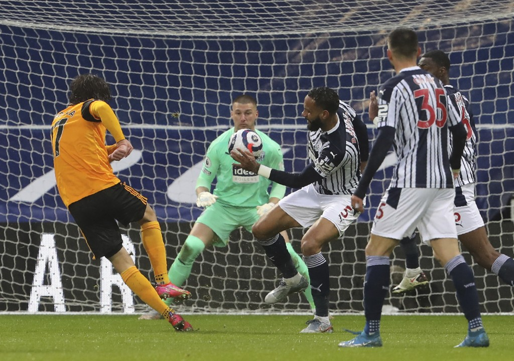 Wolverhampton Wanderers' Fabio Silva, left, scores his side's opening goal during an English Premier League soccer match between West Bromwich Albion ...