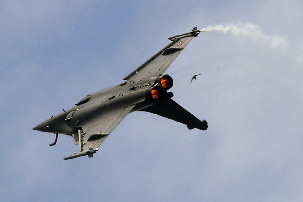 FILE- In this Tuesday, June 18, 2019, file photo, a Dassault Rafale fighter jet performs its demonstration flight at Paris Air Show, in Le Bourget, no...