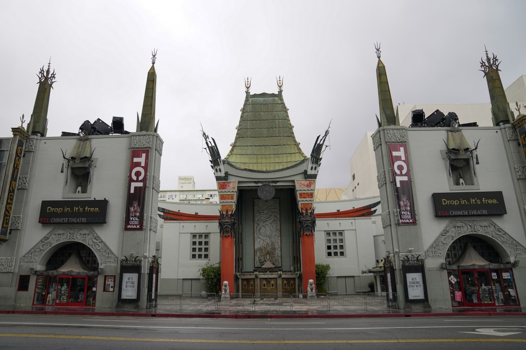 FILE - In this May 18, 2020, file photo, the TCL Chinese Theatre is shown with no people present in the Hollywood area of Los Angeles. Los Angeles Cou...