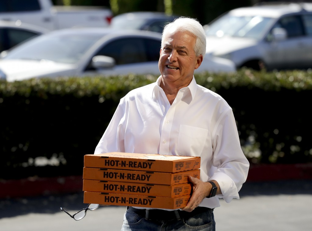 FILE - In this Nov. 6, 2018, file photo, Republican gubernatorial candidate John Cox brings lunch to the offices of Rep. Mimi Walters, R-Calif., in Ir...