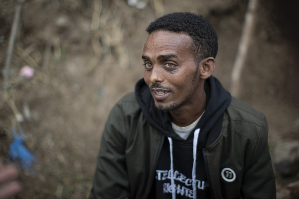 Clothes trader Gashaw Asmare, 22, who says he is striving for the kind of national unity that Ethiopia needs, speaks to The Associated Press in Gondar...